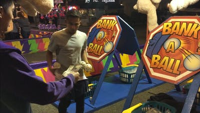 Carnival Game: How The game Bank A Ball scammed my friend! Watch his hands.